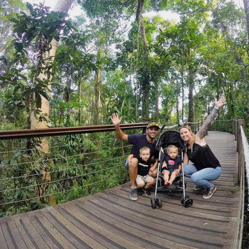 Family on rainforest boardwalk at Skyrail's Red Peak Station