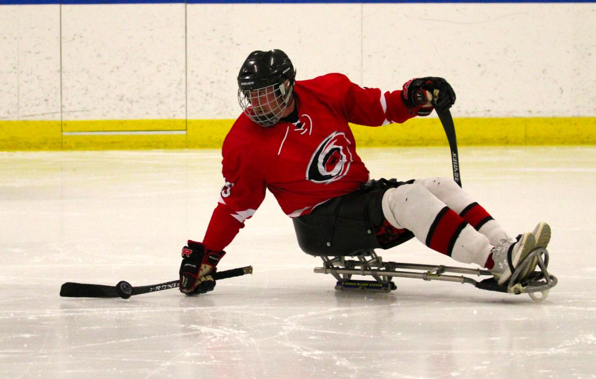 Sled hockey player catching the puck