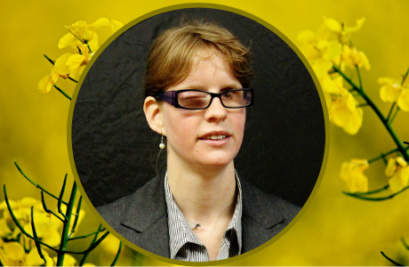 A photo of Elizabeth Mohler on a yellow background