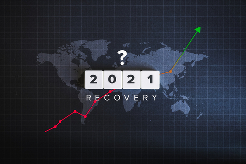 Global economic recovery and world economy 2021 concept. Block letters_ world map and financial chart on black background.