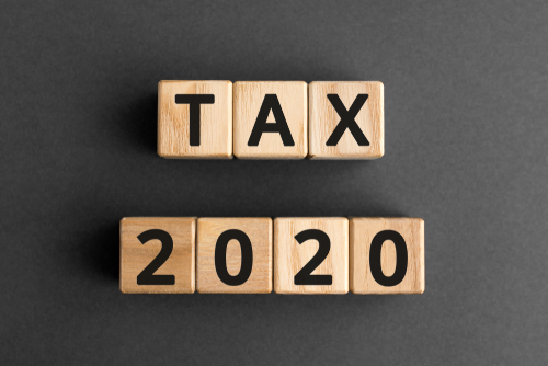 Tax 2020 - phrase from wooden blocks with letters_ Tax time 2020 concept_ top view gray background