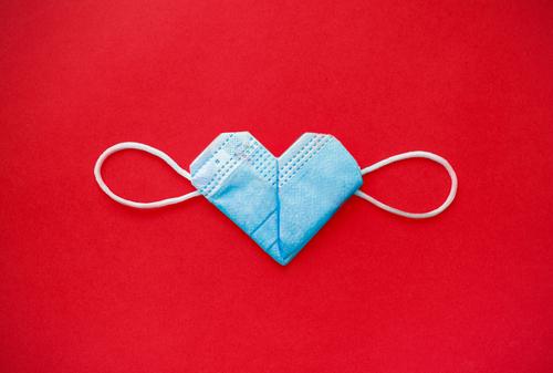 valentine s day during the coronavirus covid pandemic_ 14 February 2021. medical mask valentine