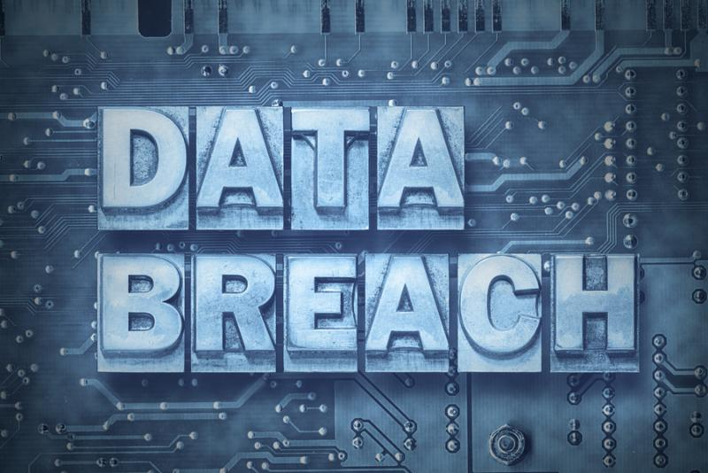 data breach made from metallic letterpress blocks on the pc board background