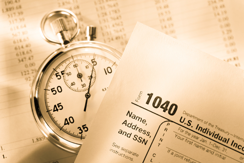 Tax form_ operating budget and stopwatch