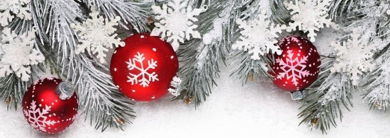 Christmas decoration with fir branch, Christmas ball and snow