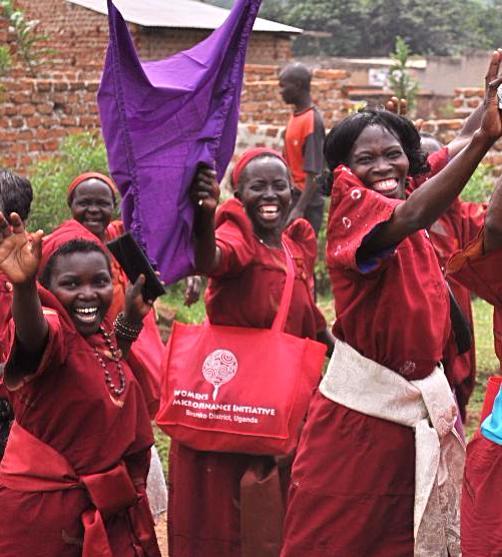 women waving in parade