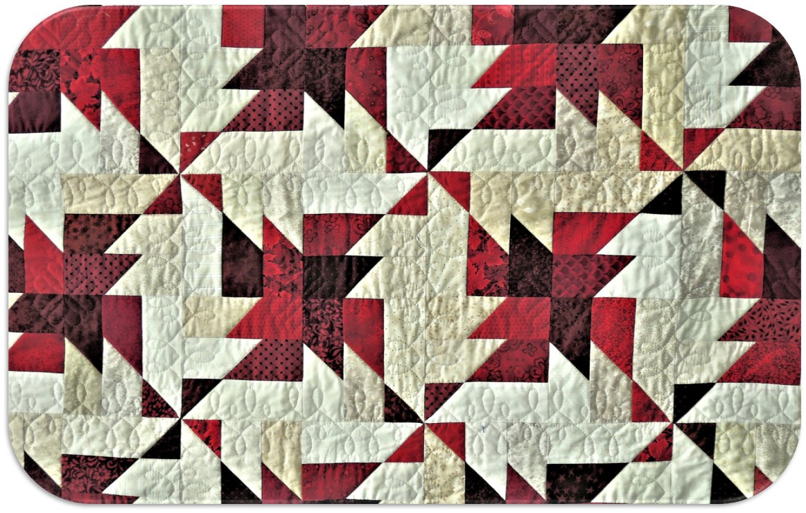 a quilt with a geometric pattern