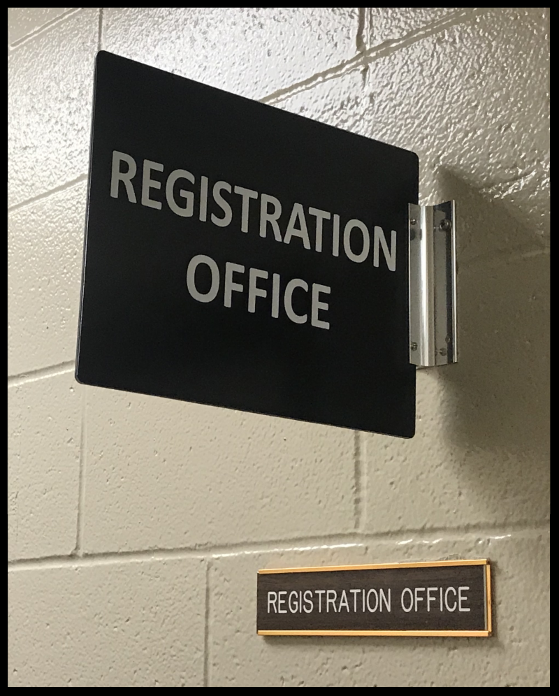 Image of a sign that says Registration Office.