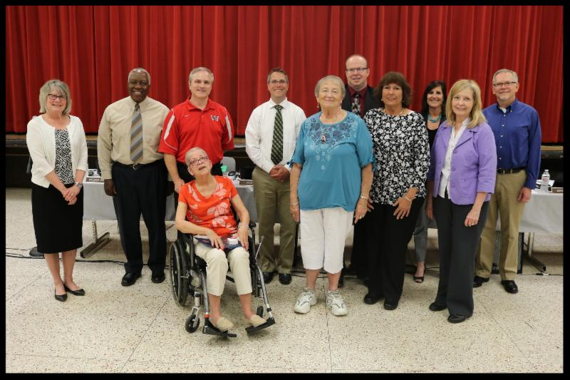 A group of retiring staff stand with Superintendent Susan Gunnell