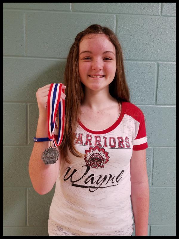 Julia Norris holds her medal