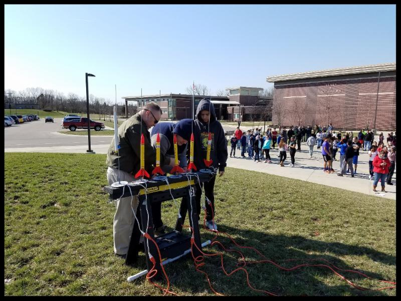 students prepare rockets for launch