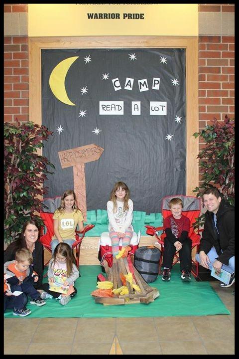 a family gathered around a pretend campfire