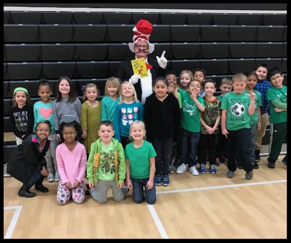 students wearing green with a man dressed as Cat in the Hat