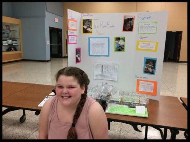 Brianna with her invention board