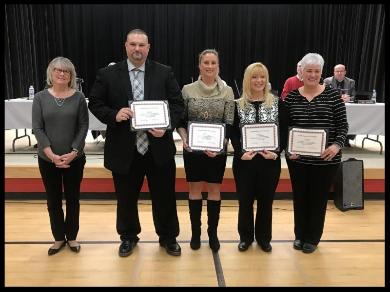 Superintendent Gunnell stands with Principal Carey and the three PLTW teachers who are smiling and holding certificates