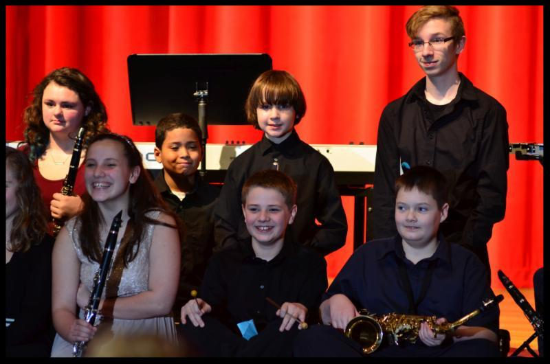Student musicians smiling