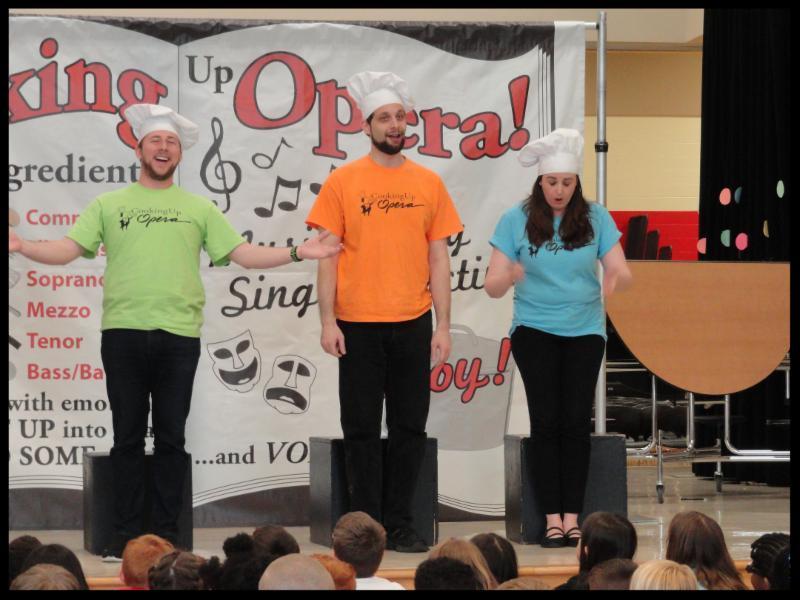 Presenters from Dayton Opera dressed like chefs