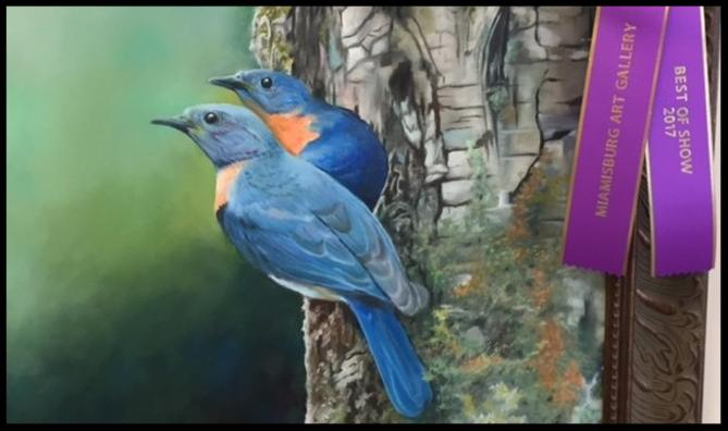 Painting of two blue birds on a tree