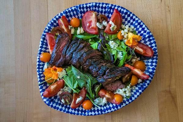 plate with grilled meat and greens