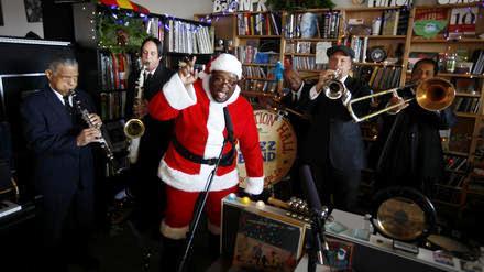 man in Santa suit with bandmates