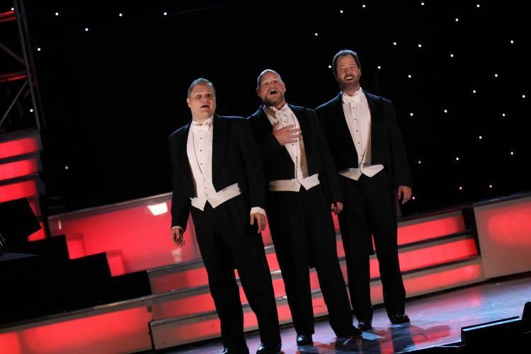 3 men in tuxedos