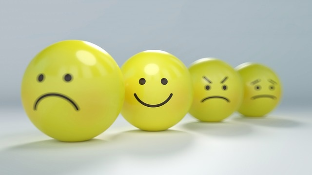yellow spheres with frowny smiley angry sad faces