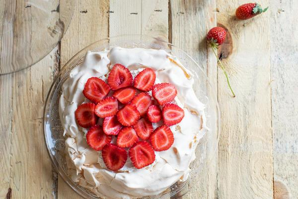 cake with white frosting and strawberries