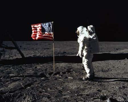 astronaut and U.S. flag on the moon