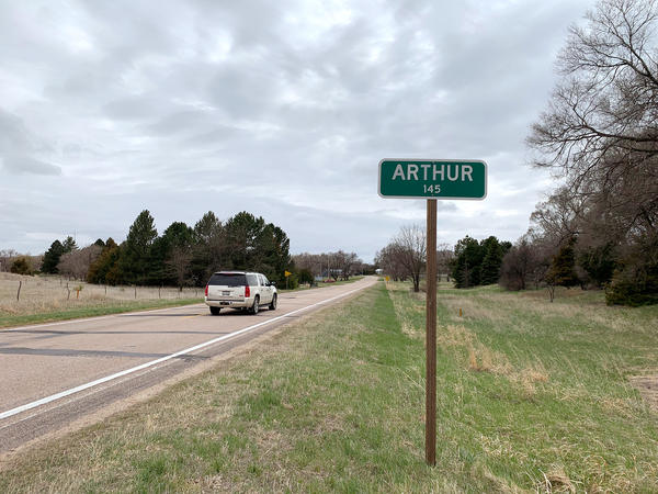 country road with town sign
