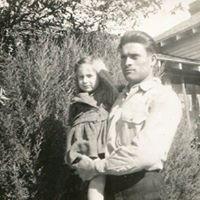 German man holding child