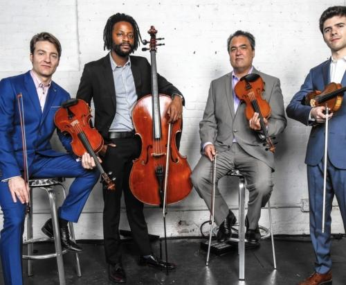 Four men with stringed instruments