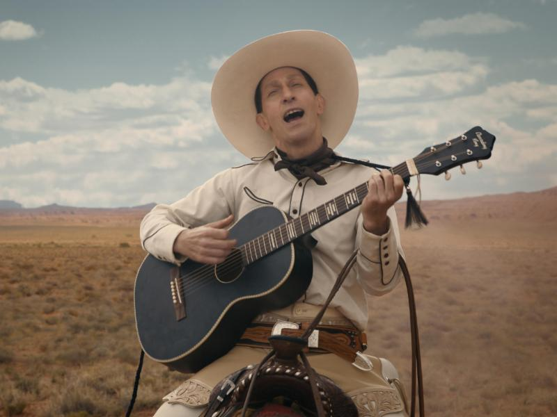 singing cowboy with guitar in desert