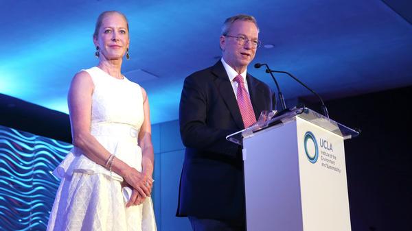 woman and man at podium