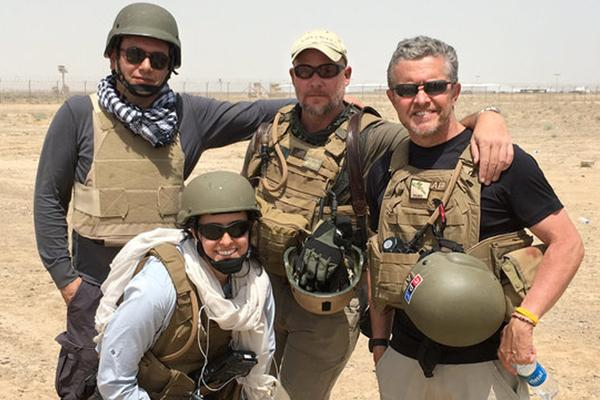 Four people wearing combat gear