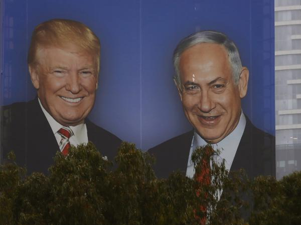 An election campaign billboard in Tel Aviv shows Israeli Prime Minister Benjamin Netanyahu with his close ally President Trump.