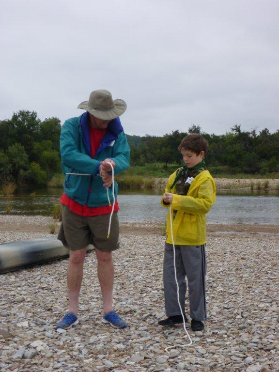 Son teaching knots to dad