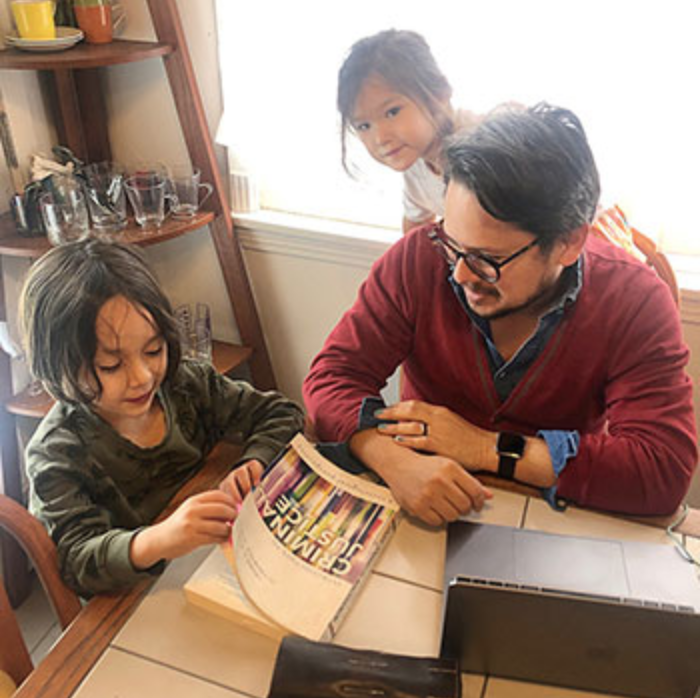 Faculty with children at computer