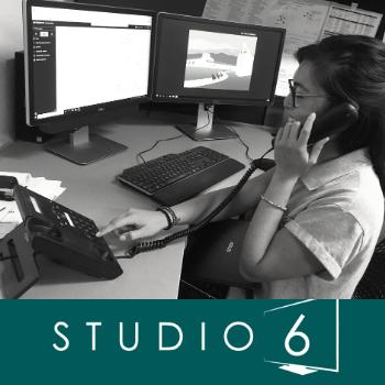 Studio 6 student on phone