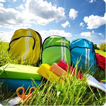 backpacks in the open grass