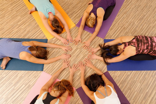 Hands of the women forming circle at Yoga class