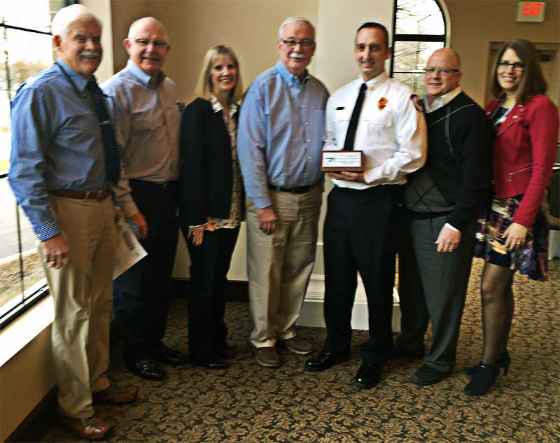 Supervisor Nash, Trustee Homan, Clerk Boersma, Treasurer Koster, Fire Chief Sipe, Manager Gallagher, Manager Burns with the brick award