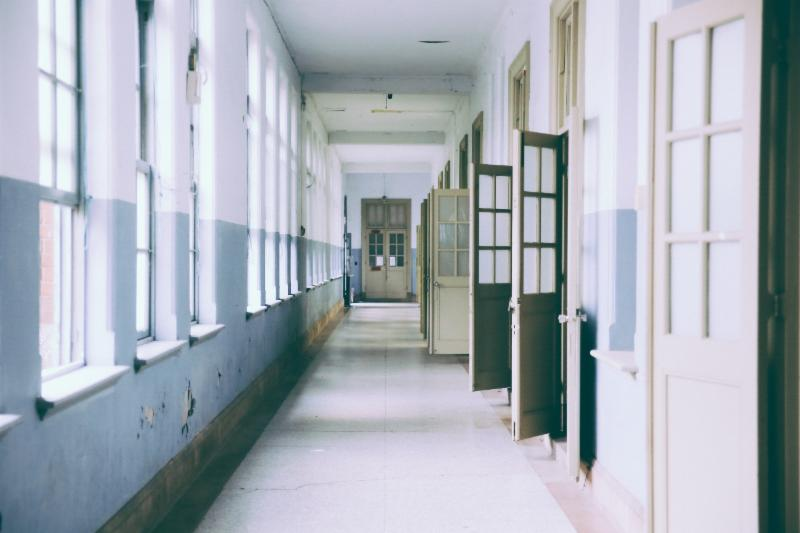 School hallway with windows on left and doors on the right