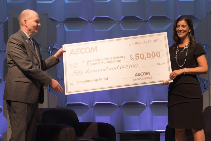 Frank Wengler, North America Aviation Executive, AECOM (left) and Heather Barry, AMAC Foundation Board Chair (right)