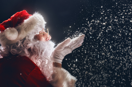 Merry Christmas and happy holidays  Santa Claus blows snow.