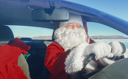 Portrait of Santa Claus in the car_ shooting was conducted in a sunny day on lake Baikal
