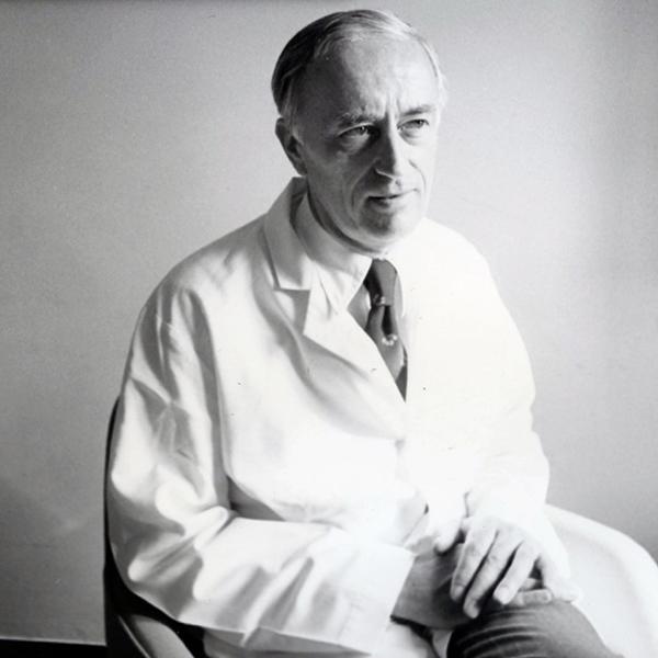 John Potter Seated Headshot with White Coat
