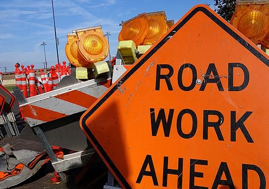 Construction scene with road work ahead sign
