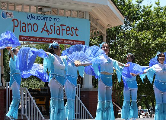 dancers dressed in blue costume at Asia Fest