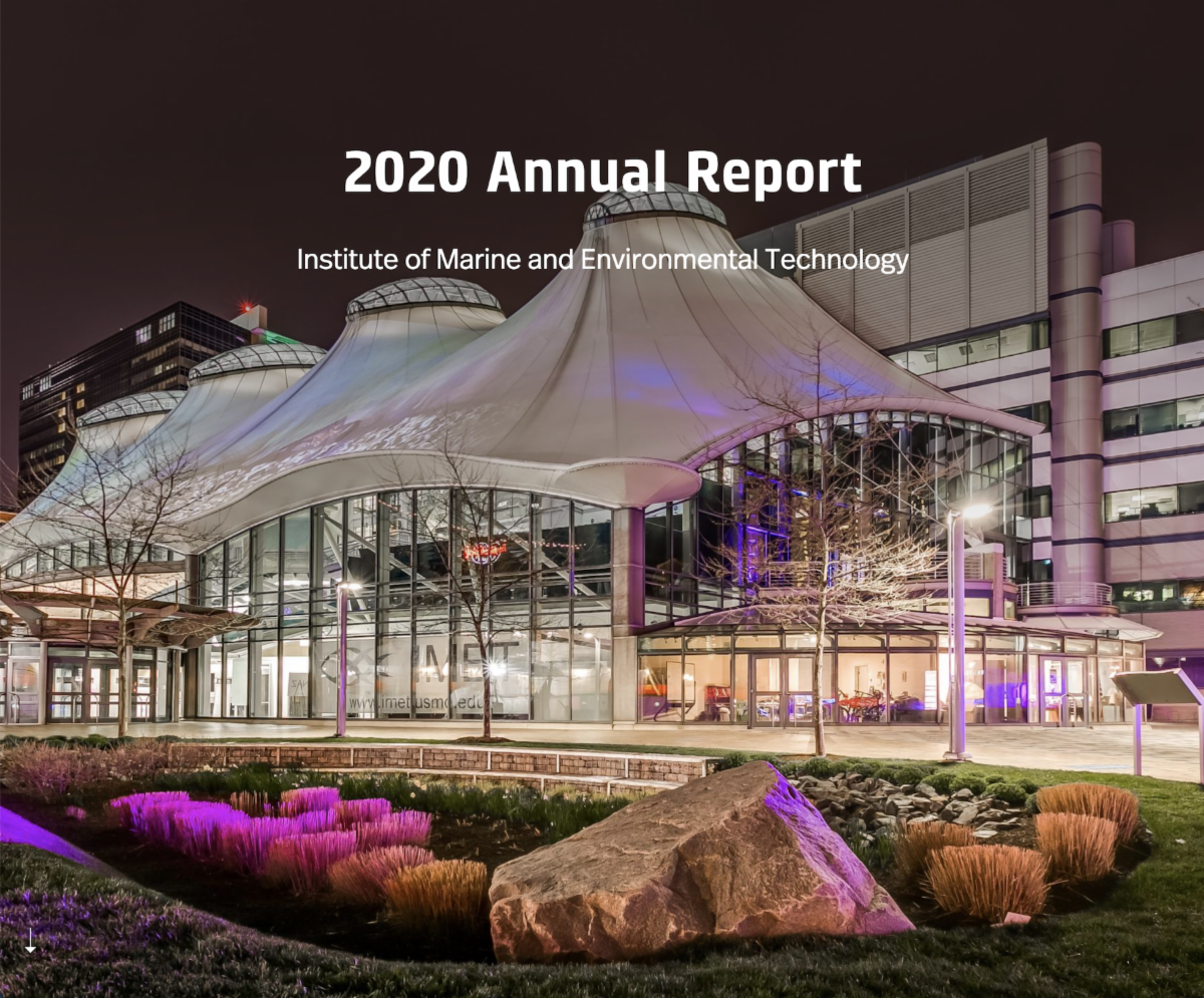 """Image of IMET building at night with text, """"2020 Annual Report"""""""