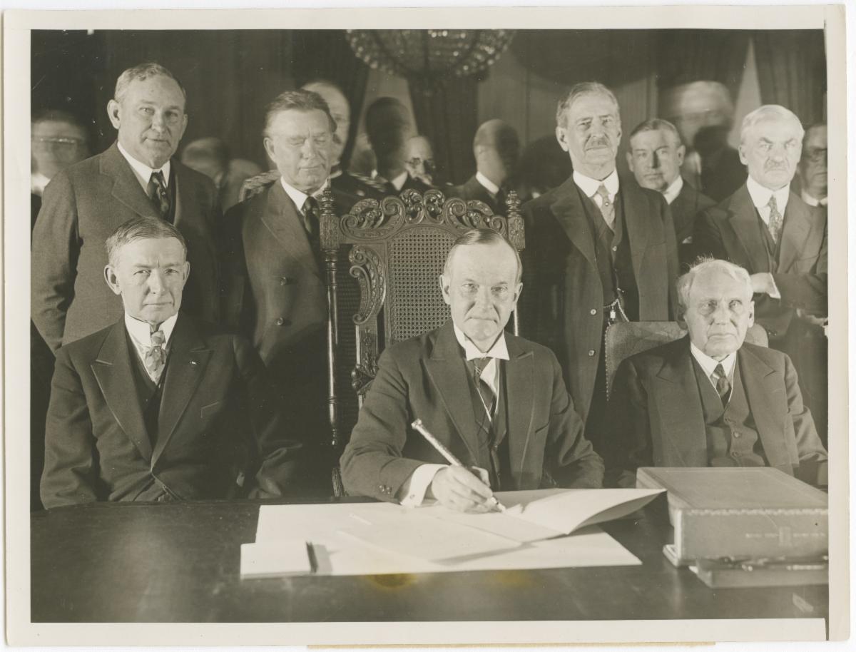 Calvin Coolidge signs Kellogg-Briand Pact